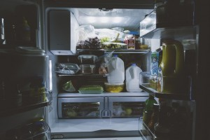 Open fridge filled with groceries