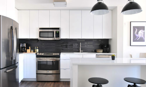 White kitchen with a modern microwave oven