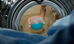 Putting detergent in the washing machine